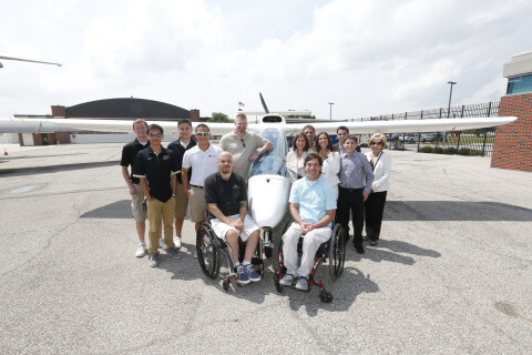 Students pose in front of the aircraft donated by the Ricci Family Foundation (Photo: Business Wire)